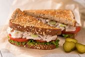 pic of tomato sandwich  - A delicious flaked white tuna salad sandwich with tomato lettuce mayonnaise and pickles - JPG