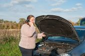 image of breakdown  - Young woman asking for help with a car breakdown - JPG