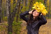 Autumn portrait of a beautiful cheerful girl.