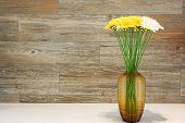 Gerbera flower on the vase wood backgrouds.