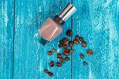 Nail polish on blue wood surface