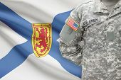 American Soldier With Canadian Province Flag On Background - Nova Scotia