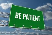The word be patient and green billboard sign against sky and clouds