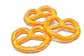 stock photo of pretzels  - three salted pretzels closeup on white background