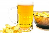 Beer In Glass And Crispy Chips