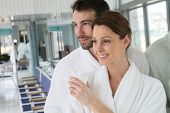 Portrait of couple in bathrobe spa center relaxation room