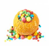 Trick or treat pumpkin filled with candy sweets