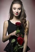 picture of lice  - Young beautiful elegant girl with lice make up in black dess is holding valentine - JPG