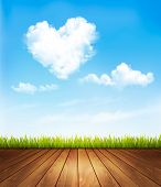 Nature background with a blue sky and heart shaped cloud.Vector illustration