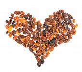 Heart shape made of dried fruits raisins
