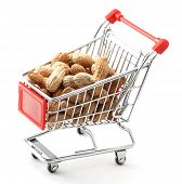 stock photo of groundnut  - close up of red chrome shopping cart with groundnuts on white background - JPG