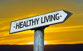 Healthy Living sign with a sunset background