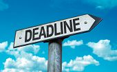 Deadline sign with sky background