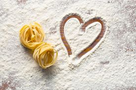 stock photo of carbohydrate  - top view of heart and pasta - JPG