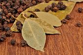 picture of peppercorns  - Top view of bay leaves and peppercorns close up - JPG