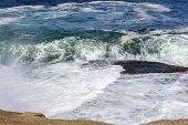 stock photo of ipanema  - Waves crashing on Arpoador beach stones in Ipanema - JPG