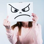 foto of disapproval  - Angry young woman showing middle finger - JPG