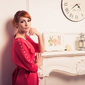pic of young woman posing the camera  - Beautiful young fashionable woman posing in red dress - JPG