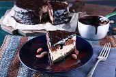 picture of icing  - Delicious chocolate cake with icing in plate on table - JPG