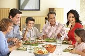 image of extend  - Extended Hispanic Family Enjoying Meal At Home - JPG