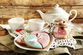 picture of teapot  - Heart shaped cookies for valentines day and teapot on  wooden background - JPG
