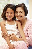 image of granddaughters  - Hispanic grandmother and granddaughter - JPG