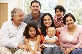 stock photo of three sisters  - 3 generation Hispanic family at home - JPG