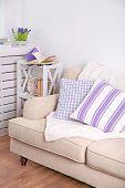 stock photo of comforter  - Modern room with comfortable sofa - JPG
