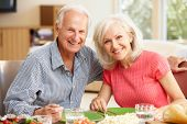 image of father daughter  - Father and adult daughter sharing meal - JPG