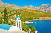 stock photo of greek-island  - Blue dome of Greek church with sea bay of Greek Islands - JPG