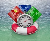 foto of stopwatch  - credit cards and stopwatch on a lifebouy - JPG