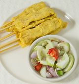 pic of sate  - Food and Cuisine A Dish of Grilled Pork Satay on Bamboo Skewer Served with Cucumber Salad - JPG