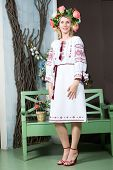 stock photo of traditional dress  - Attractive young woman in traditional Ukrainian dress - JPG