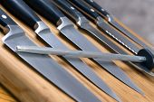 stock photo of chef knife  - a set of high quality kitchen knives on a cutting board - JPG