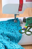 stock photo of sewing  - Sewing machine and sewing accessories on wooden table - JPG