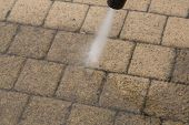 picture of water jet  - Outdoor floor cleaning with high pressure water jet - JPG