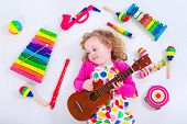 stock photo of flute  - Child with music instruments - JPG