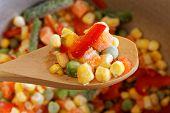image of frozen  - Closeup wooden spoon with frozen mixed vegetables - JPG