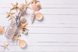 foto of marines  - Marine items and candles on white painted wooden background - JPG