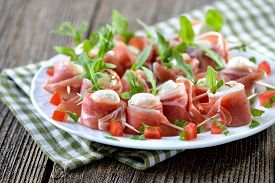 picture of drop oil  - Mozzarella balls with delicious South Tyrolean smoked bacon - JPG