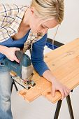 Home Improvement - Handywoman Cutting Wooden Floor