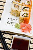 Sushi (Rolls) On A Plate, Chopsticks, Wasabi, Sauce poster