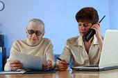 Social worker helping senior woman