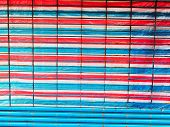 red white and blue canvas and grill of shop front