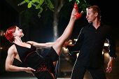 picture of ballroom dancing  - Couple dancing on a street at night - JPG