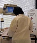 Phlebotomist With Machine