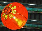 Chinese red lantern above escalator
