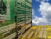 close up of circuit boards against a blue sky