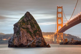 picture of golden gate bridge  - The Golden Gate Bridge and a weathered rock in the San Francisco Bay - JPG