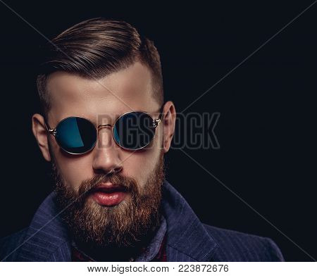 poster of Portrait of bearded man in sunglasses. Isolated on black background.